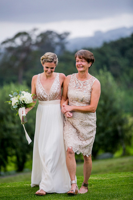 bride walking to ceremony with her mother
