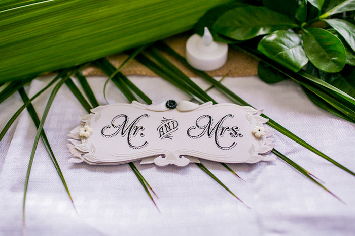 Mr. and Mrs. sign at wedding reception