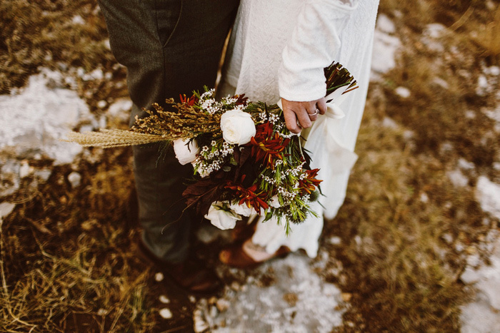 bride carrying fall wedding bouquet