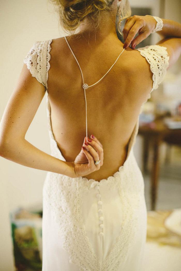 bride adjusting back chain