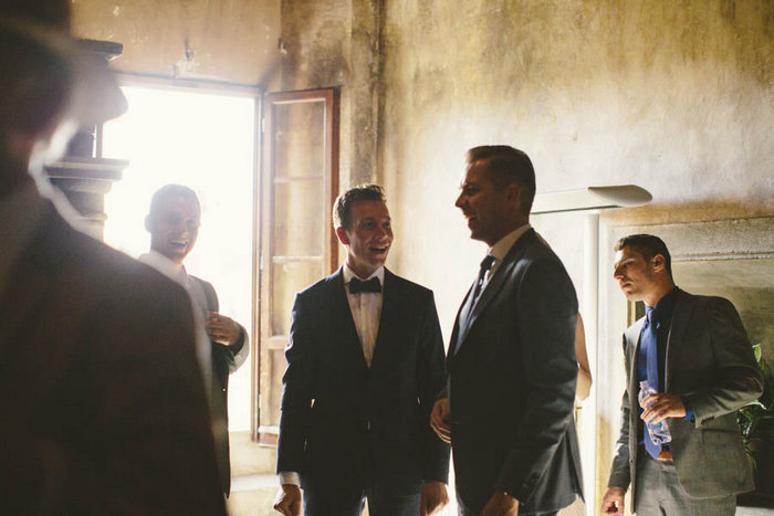 groom with wedding guests