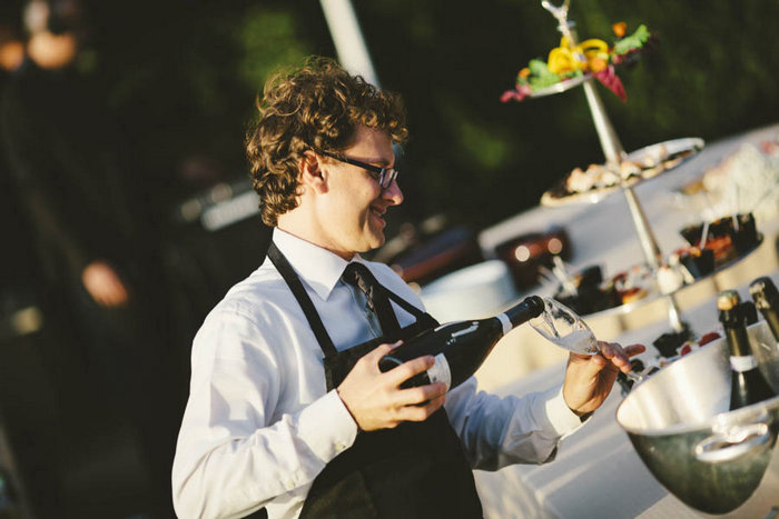 server pouring champagne