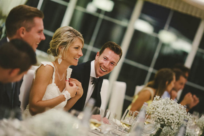 bride and groom at reception dinner