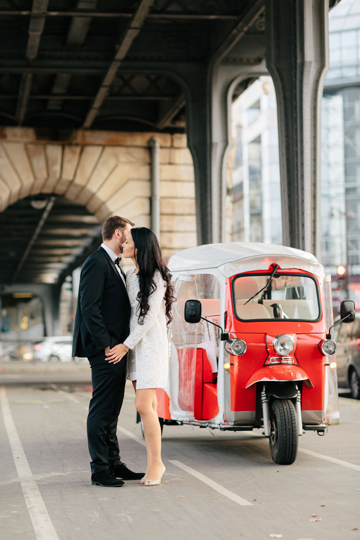 bride and groom portrait with covered scooter