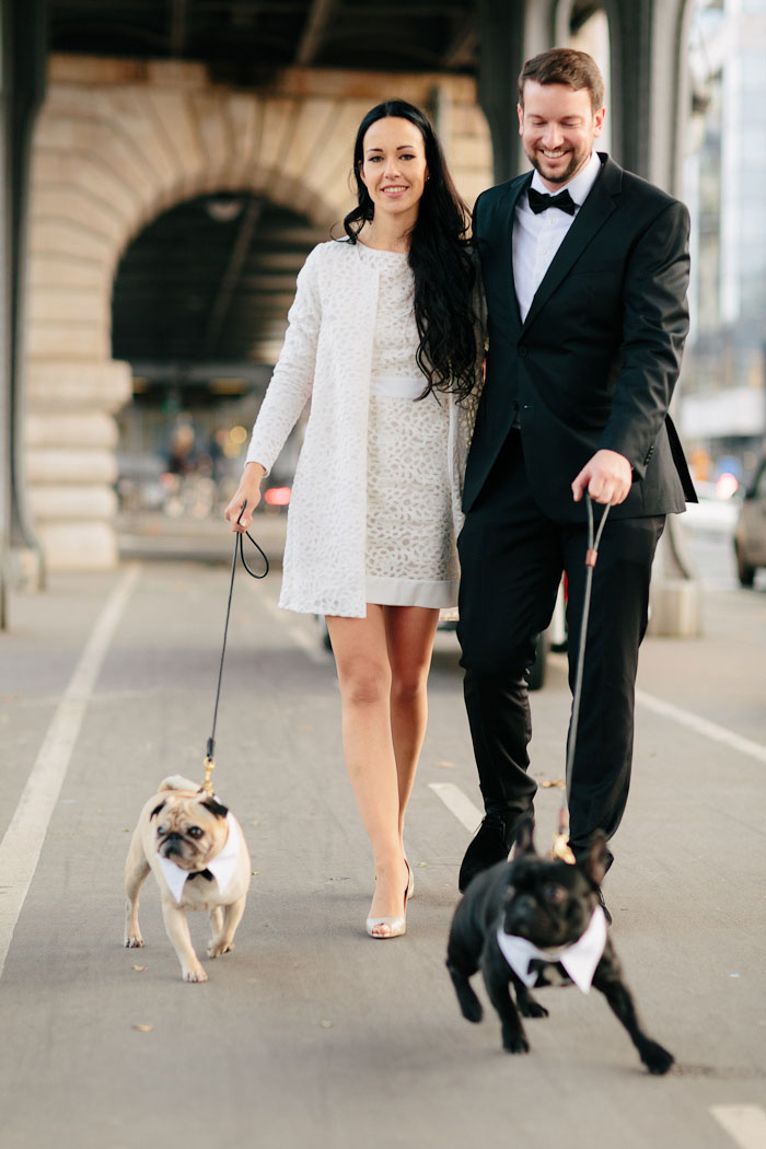 bride and groom walking dogs in Paris