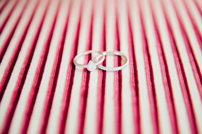 wedding rings on striped fabric