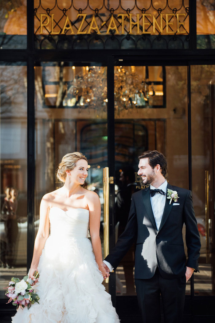 bride and groom outside Paris hotel