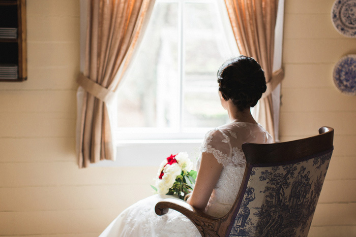 bride sitting by window