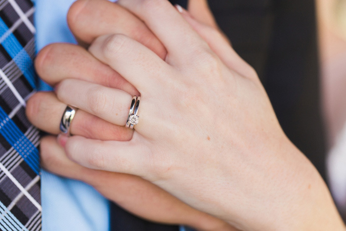 bride and groom hands intertwined