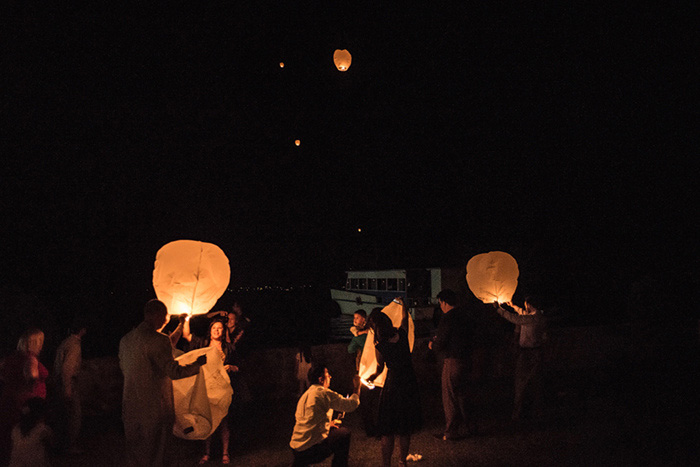 wedding guests releasing wish lanterns