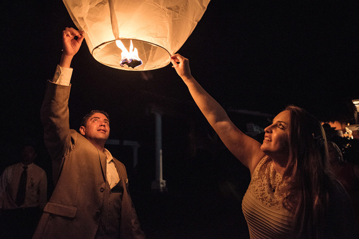 bride and groom releasing wish lantern