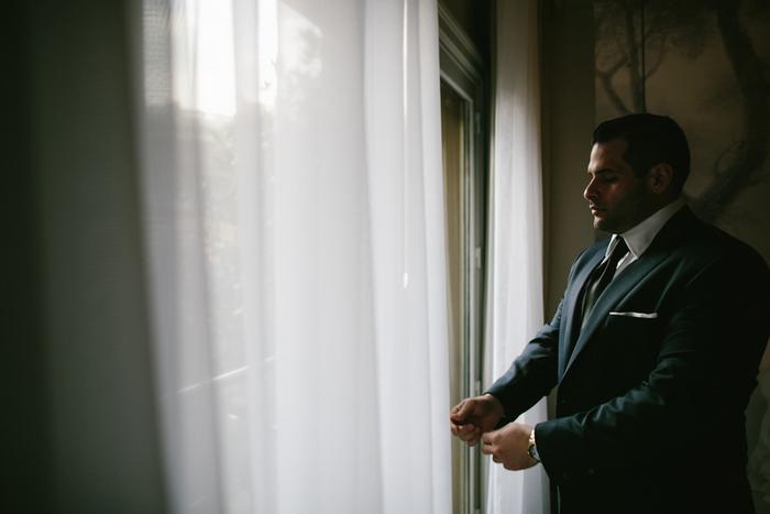 groom adjusting his jacket sleeves