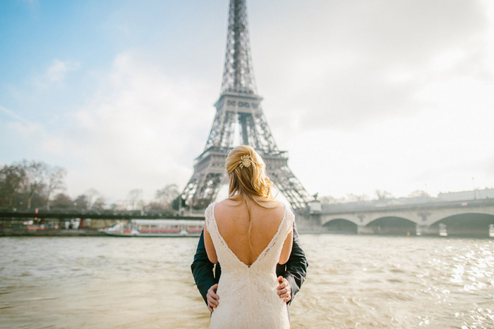 bride and groom kissing in front of Eiffel Tower