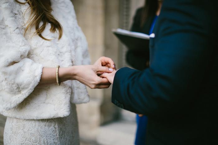 bride puttingring on groom's finger