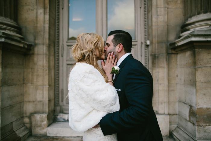 Bride and groom kising