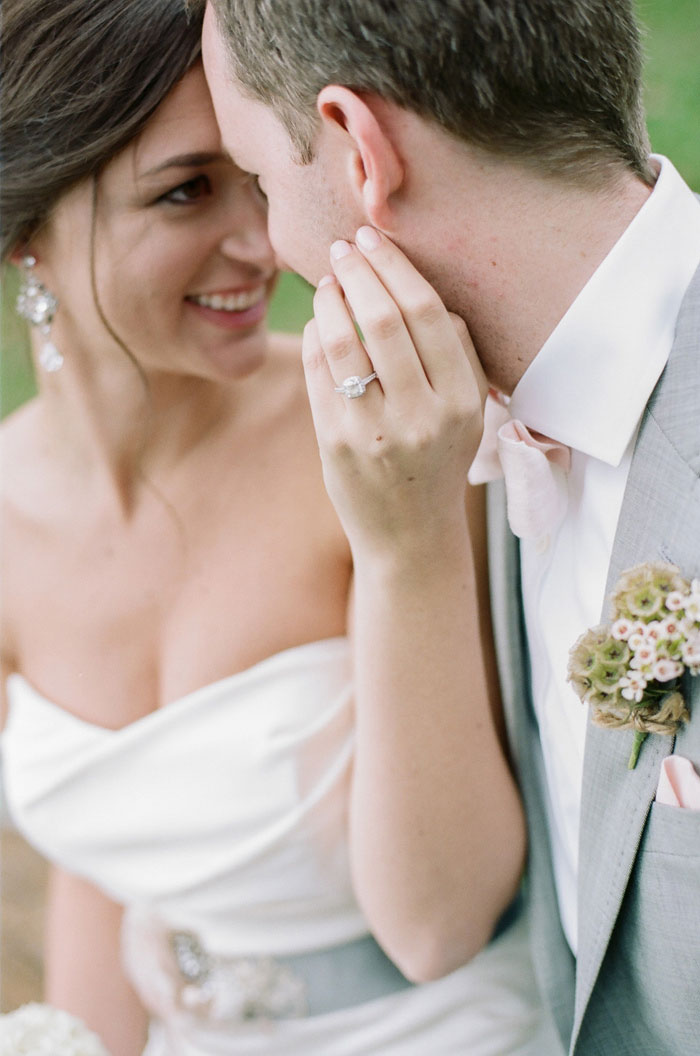 bride touching groom's face