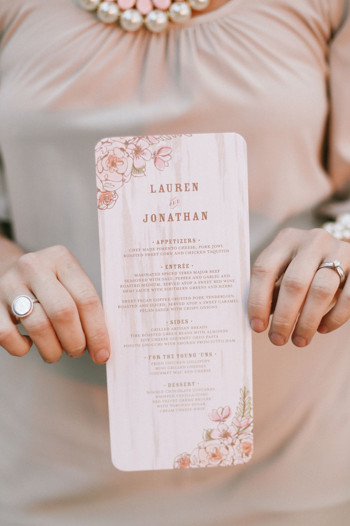 guest holding wedding menu