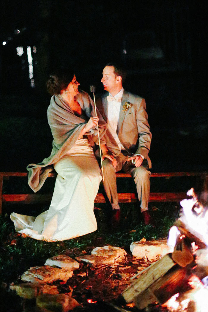 bride and groom toasting marshmallows