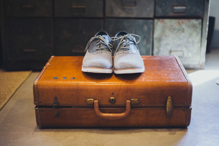 groom's shoeson suitcase