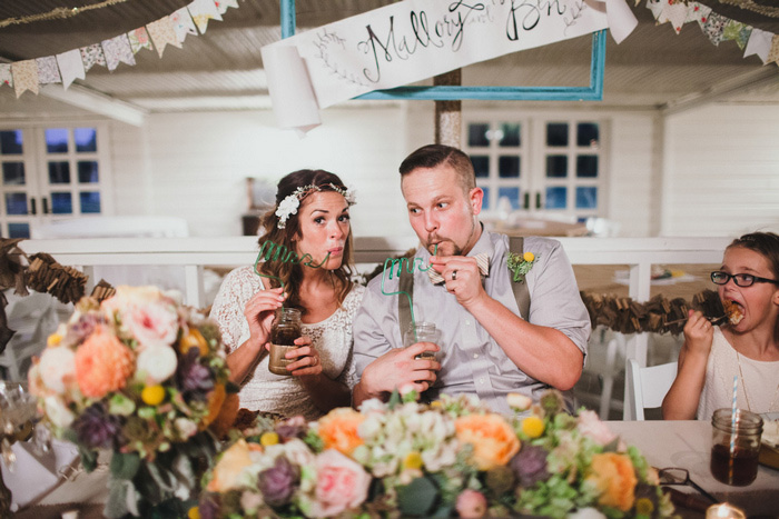 bride and groom drinking through Mrs. and Mr. straws