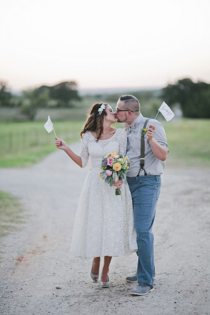 bride and groom with yay flags