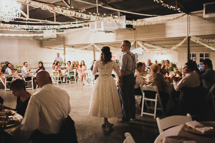 bride and groom at barn reception