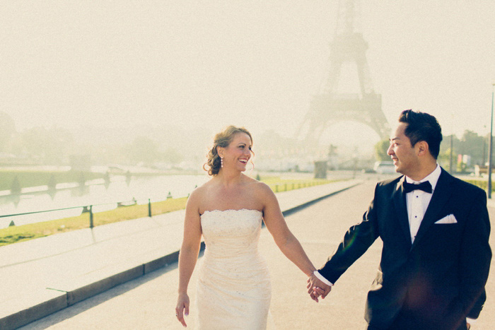 bride and groom walking hand in hand in Paris