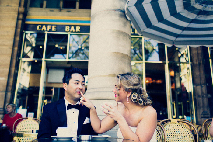 bride and groom having coffee in Paris