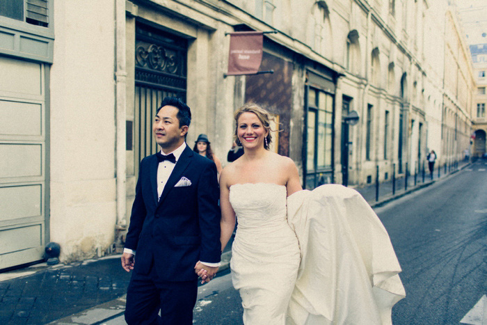bride and groom walking down Paris street