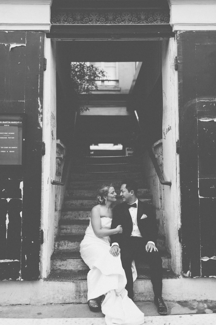 bride and groom in Paris stairwell