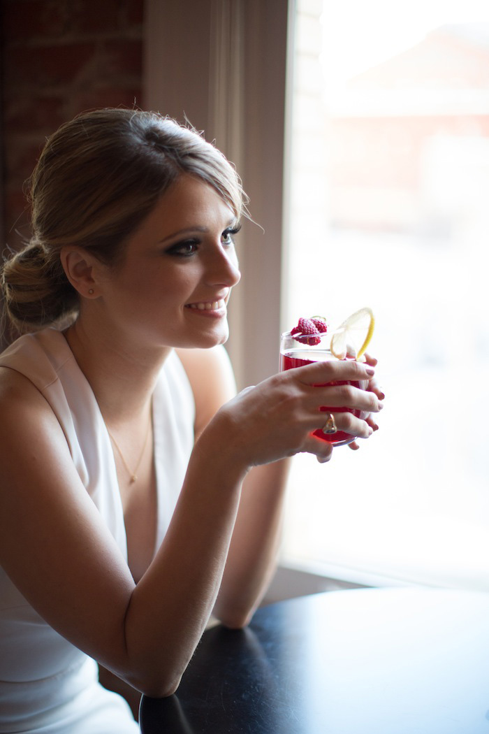 bride drinking cocktail