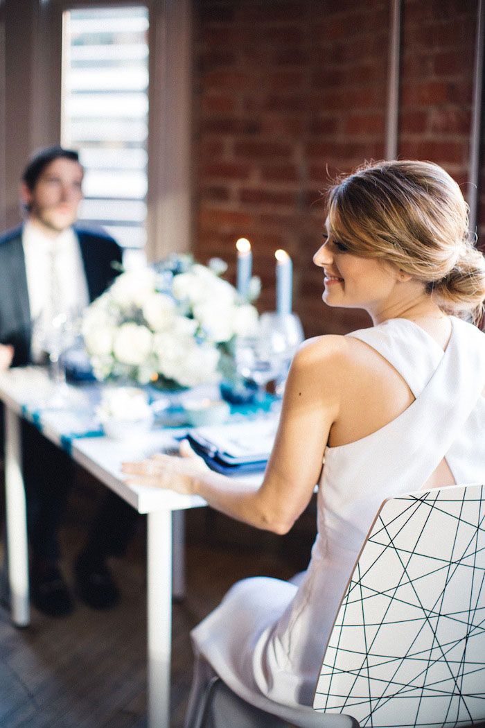 bride sitting at dinner table