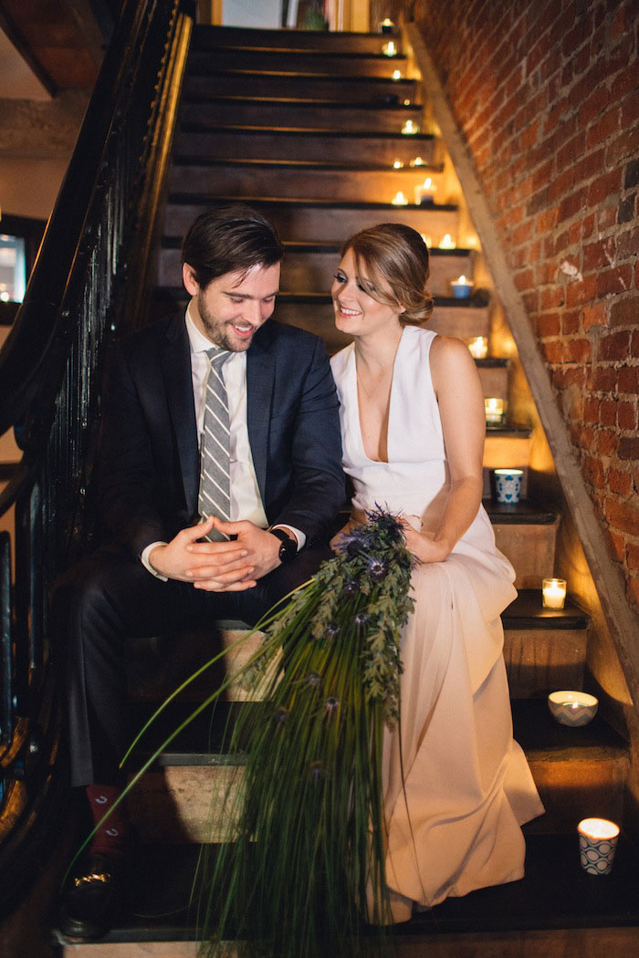 bride and groom on candlelit stairs