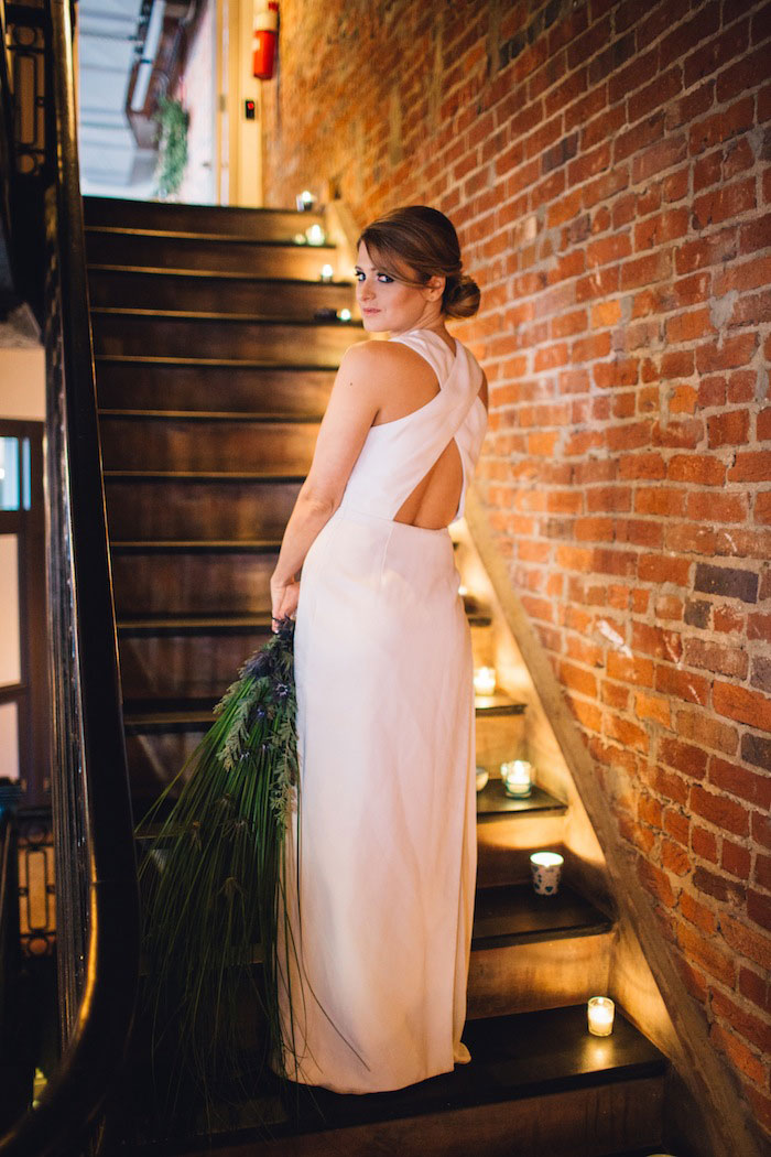 bride on candlelit stairs