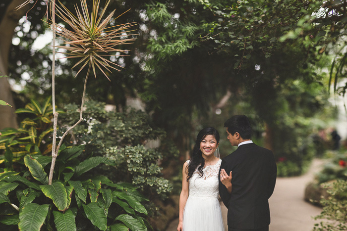 bride and groom portrait in conservatory