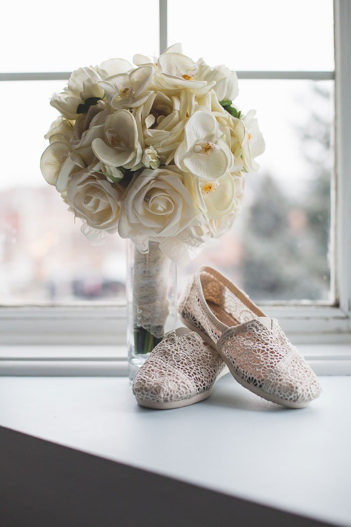 white rose wedding bouquet and lace Tom's shoes