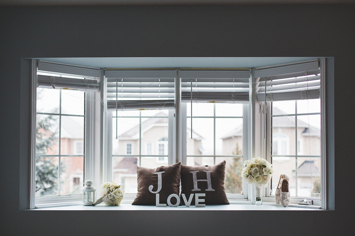 monogrammed pillows and love sign on window seat