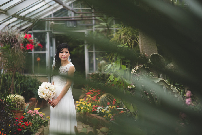 bride portrait through plant leaves