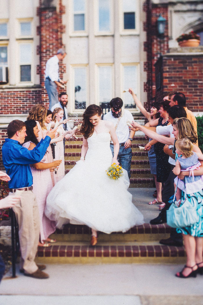 bride and groom exit with rice toss