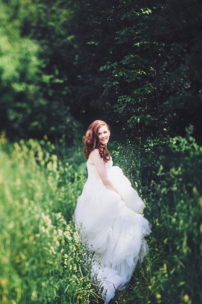 bride walking through tall grass