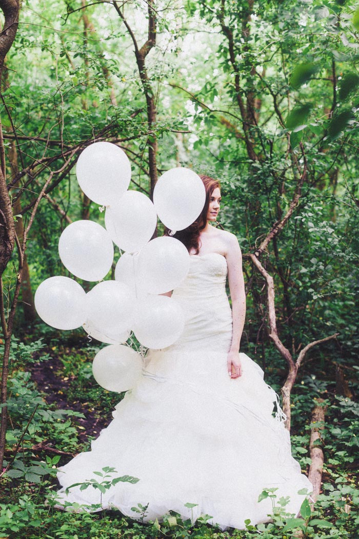 bride with white balloons