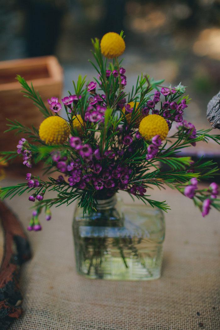 purple and yellow flower cnterpiece