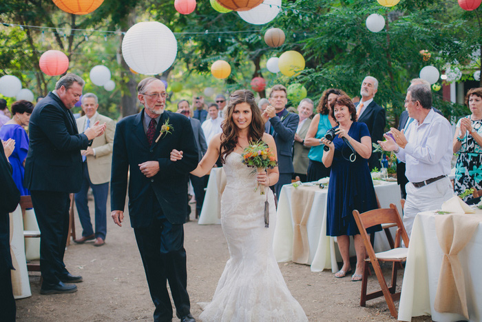 bride walking down aisle with father