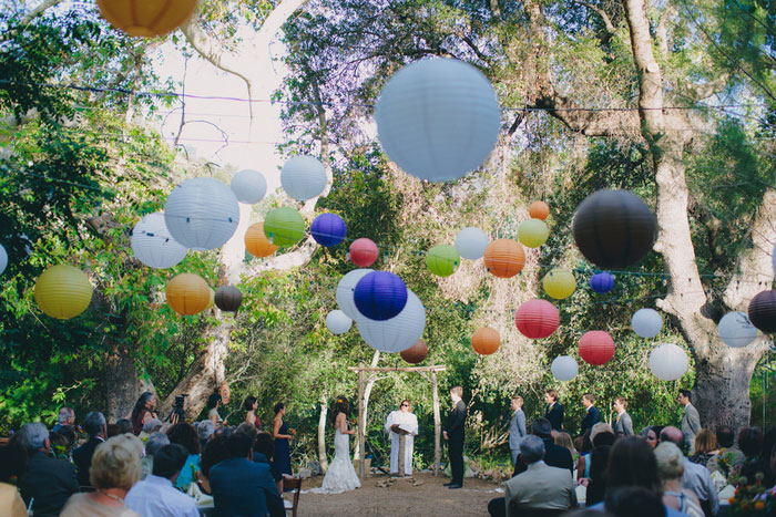 outdoor wedding ceremony set-up with paper lanterns