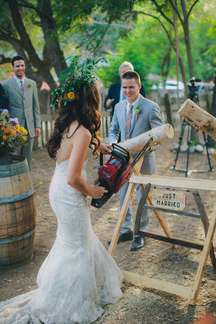 bride cutting log with chainsaw