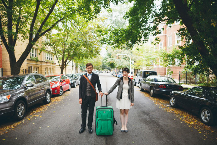 bride and groom with suitcase