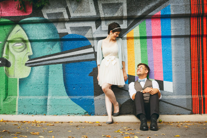 bride and groom portrait in front of colorful mural