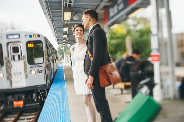 bride and groom waiting for the subway