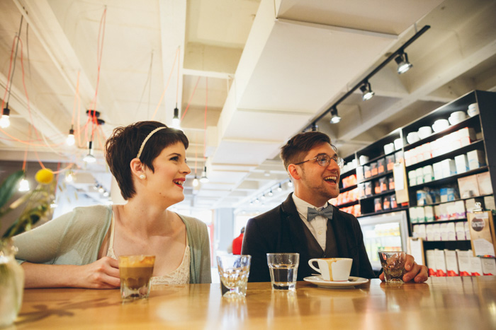 bride and groom tasting coffee