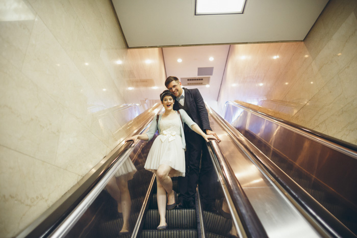 bride and groom on escalator